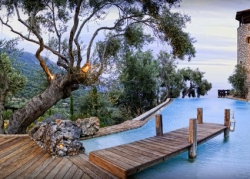 Pool and views of the hillside at dusk in Corfu